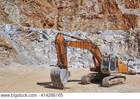 Heavy Excavator On A Quarry. Excavation Machinery. Earthmover