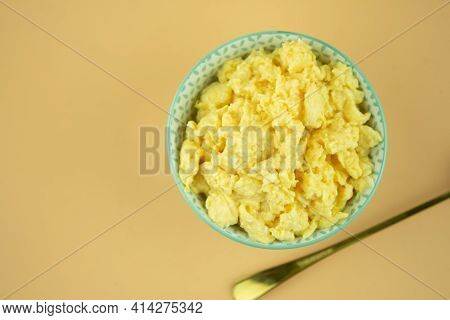 Scrambled Eggs In Bowl. Yolk And White Are Stirred And Beaten Together, Then Cooked And Ready To Eat