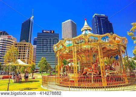 Perth, Western Australia - Jan 3, 2018: Traditional Venetian Carousel At Elizabeth Quay. Modern Skys