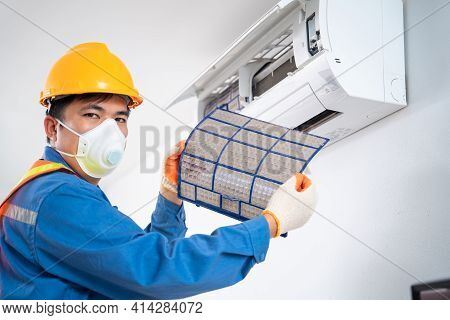 Air Mechanic Shows A Filter That Has A Lot Of Dust Pulled From The Air Conditioner, The Concept Of C