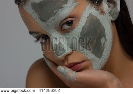 Close-up Portrait Of The Cleanliness Face Of A Beautiful Woman With Dark Black Smoky Eyes Makeup, Na