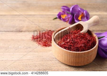 Dried Saffron And Crocus Flowers On Wooden Table, Space For Text