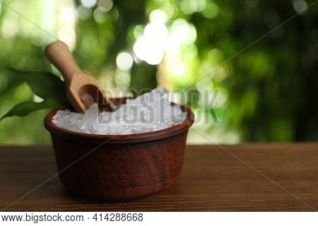 Bowl With Menthol Crystals, Leaves And Scoop On Wooden Table Against Blurred Background. Space For T