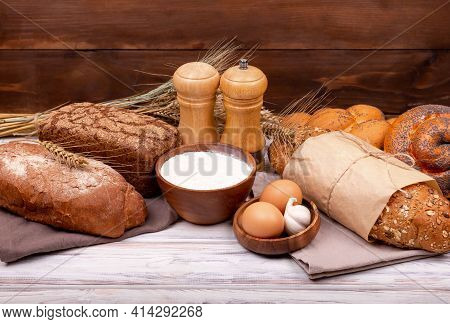 Home Bread Baking Background. Process Of Making Homemade Bread. Fresh Dough Over White Table With Fl