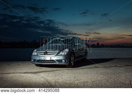 Dnepropetrovsk, Ukraine - 03.15.2021: Car Mercedes-benz R 350 On The Embankment Against The Skyline