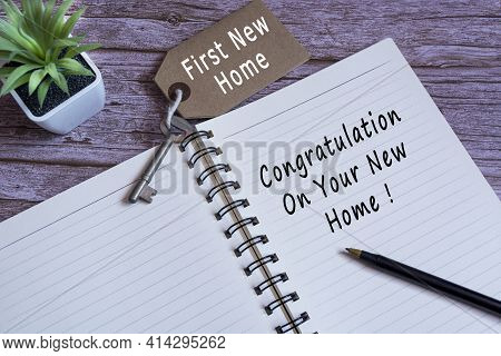 Text Written On Notebook With Potted Plant And A Pen - Congratulation On Your New Home