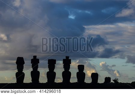 Silhouettes Of The Moais From The Ahu Nau Nau, Located In A Few Meters Away From The White Sands Of