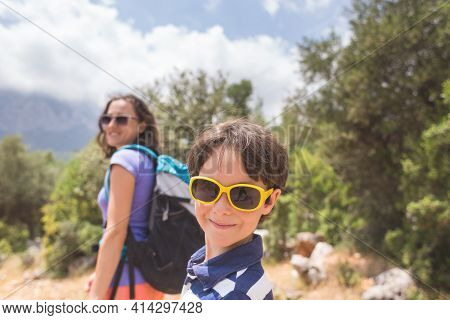 Portrait Of A Boy With Mom On A Background Of Mountains, A Woman Travels With A Child, A Girl With A