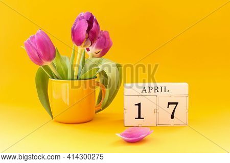 Calendar For April 17: Cubes With The Number 17 , The Name Of The Month April In English, A Bouquet