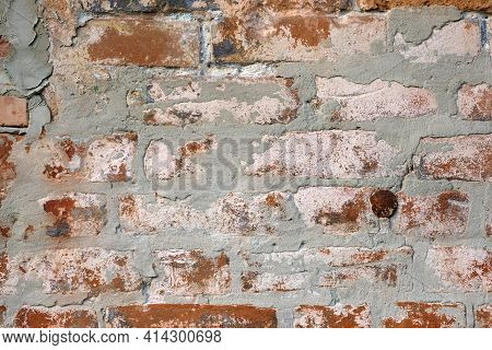 Old Brick Wall With Cement, Texture. Cement Grunge Wall Close Up. Vintage Old Red Brick Wall Backgro