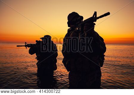 Two Commando Soldiers, Army Special Operations Fighters Aiming Assault Rifles While Coming Out From