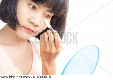 Concealer Stick. Asian Woman Authentic Black Hair And Skin Tan Smear Concealer Under Eyes On Face Fo