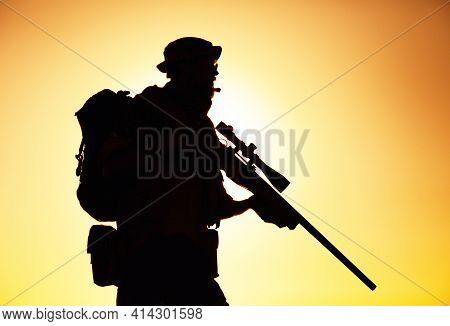Silhouette Of Army Elite Forces Sniper, Commando Shooter In Boonie Hat, Carrying Backpack, Equipped