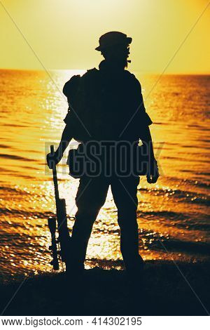 Silhouette Of Army Commando Fighter, Navy Seals Team Sniper Or Coast Guard Soldier Standing On Sea S