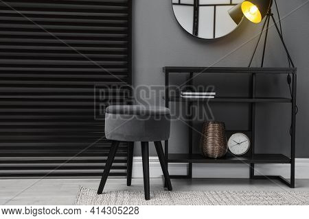 Console Table With Stool And Mirror On Grey Wall In Room. Interior Design