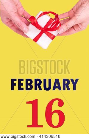 February 16th. Festive Vertical Calendar With Hands Holding White Gift Box With Red Ribbon And Calen