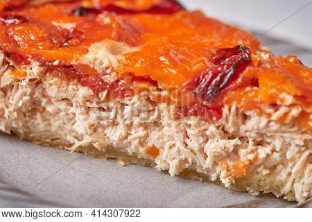 Piece Of Homemade Quiche Pie With Chicken, Dried Tomatoes, Cheddar Cheese. Selective Focus, Macro