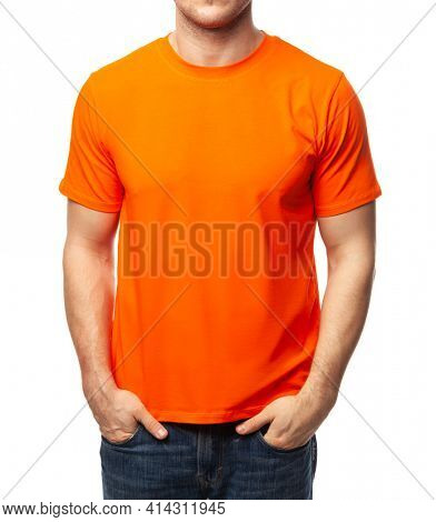 Young fit man wearing blank orange shortsleeve cotton T-Shirt. Mock up template isolated on a white background