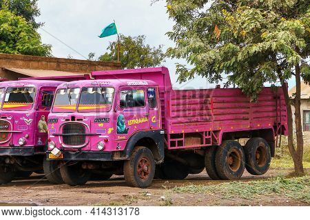 Arusha, Tanzania - February 8, 2021: Pink Flatbed Truck Fiat 643 In The City Street.