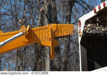Wood Chipper Machine Releasing The Shredded Woods Truck