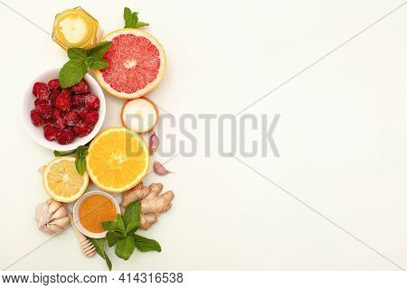 Set Of Natural Fruits To Boost Immune System On White, Copy Space. Superfoods For Immunity Boosting