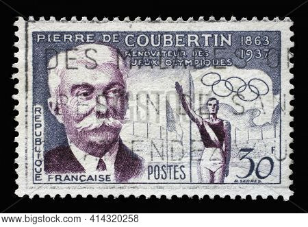ZAGREB, CROATIA - SEPTEMBER 09, 2014: Stamp printed in the France issued in honor of Baron Pierre de Coubertin, shows Pierre de Coubertin and Olympic stadium, Famous people series, circa 1956.