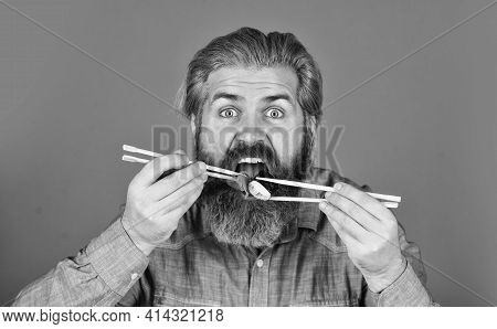 Sushi Rolls. Japanese Cuisine. Asian Meal. Sushi Roll. Man Eat Sushi Chopsticks. Eastern Culture. Be