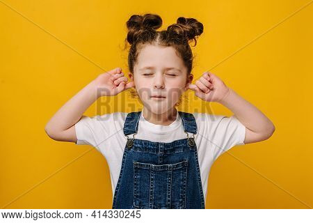 Unhappy Little Girl Kid With Having Discontent Look Plugging Her Ears Being Annoyed With Noise Wanti