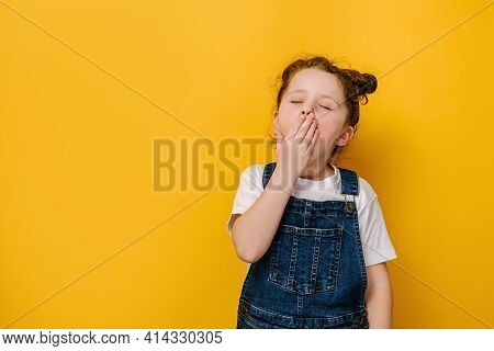 Little Preschool Girl Feeling Tired Or Sleepy Cover Mouth With Hand Closed Eyes Yawning, Isolated On