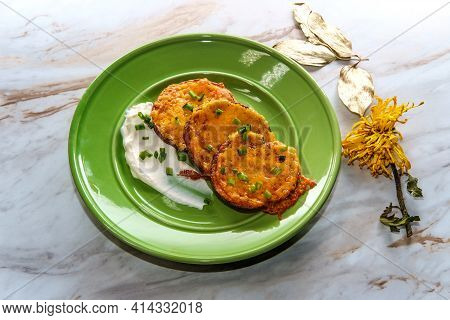 Cheesy Oven Roasted Cheddar Potato Rounds With Sour Cream And Chive Garnish