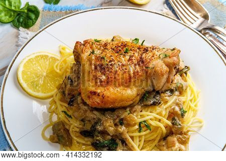 Crispy Baked Chicken Thighs In A Creamy Spinach Artichoke Heart Sauce