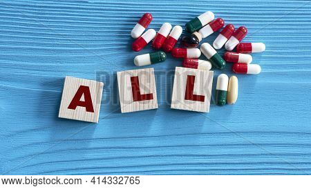 All ( Acute Lymphoblastic Leukemia) - Acronym On Wooden Cubes On A Blue Background With Tablets. Med