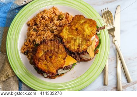 Authentic Puerto Rican Cuisine Skirt Steak Jibarito Plantain Sandwich Served With Side Of Arroz Con