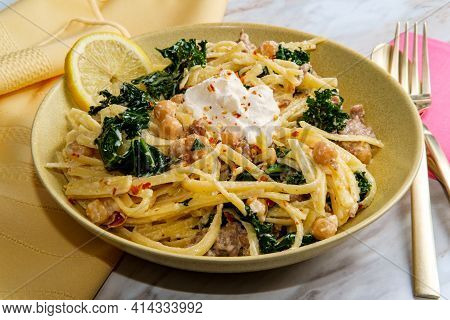 Linguine Pasta With Italian Sausage Chickpeas And Kale In A Creamy Ricotta Cheese Sauce