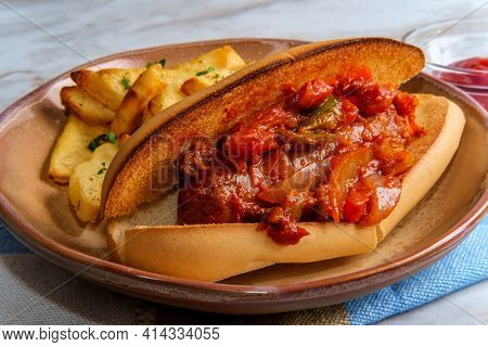Sausage Onions And Peppers Hoagie Sandwich With Side Of Steak Fries