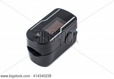 Black Pulse Oximeter Close-up. Isolated On White Background. Measurement Of Blood Oxygen Level And P