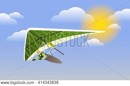 Hang Glider In Helmet And Uniform Soaring Thermal Updrafts Suspended On Harness Below The Wing. Hang