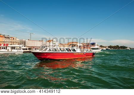 Venice, Italy. 04 September 2018. View Of The Canal And The Venetian Boats And Yachts Transporting T