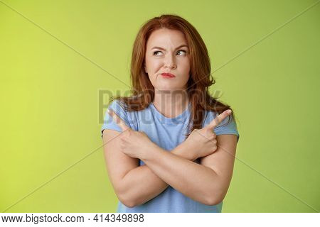 Time Make Right Choice. Perplexed Hesitant Redhead Middle-aged Female Customer Deciding Between Few