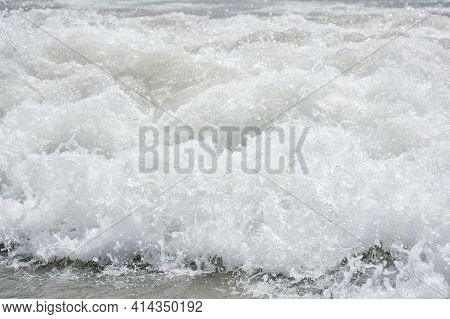 Spain L Estartit, July 1 2018. Sea Salty Wave Pours Along The Shore With Lots Of Water Splashes And