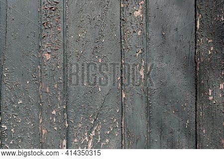 Dark Green Peeling Paint Background Texture. Wooden Door With Weathered And Peeling Paint