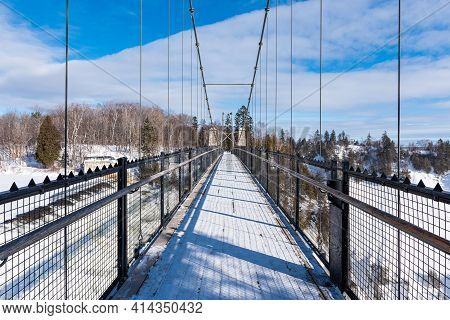 Winter View Of The Bridge Above The Montmorency Falls, In Quebec City.