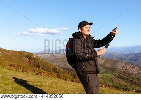 Mountaineer Using His Smartphone As A Gps To Guide Himself Through The Mountains. Person Indicated A