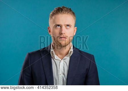 Irritated Businessman Sighs, Rolling Eyes On Blue Background. European Guy In Displeasure, He Is Tir