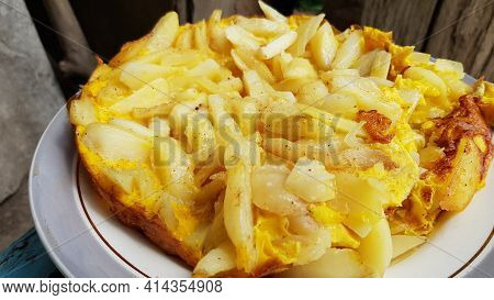 Potato Gratin Casserole In White Baking Dish With Eggs And Golden Crust. Rustic Authentic Recipe Of