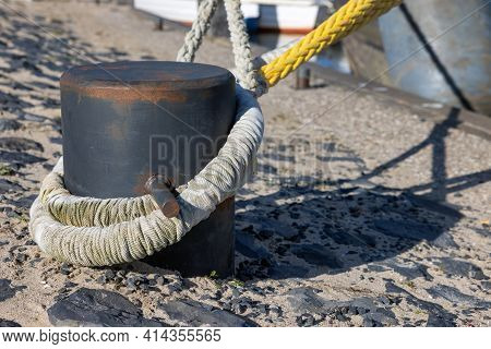 Detail Steel Bollard With Tight Ropes Of Moored Ships
