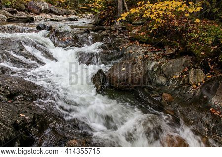River with stones and  foliage colors around