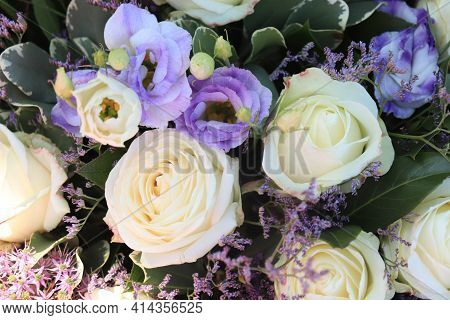 White And Purple Flower Arrangement. White Roses And Various Sorts Of Purple Flowers