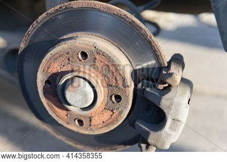 Car Brake Disc. An Old Brake Disc That Needs To Be Replaced. Rusty Disk.