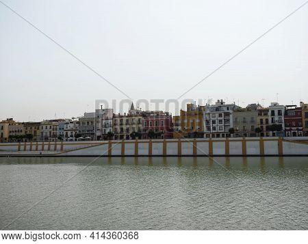 Panorama View Towards Triana Neighborhood Riverside Waterfront Promenade Esplanade At Guadalquivir R